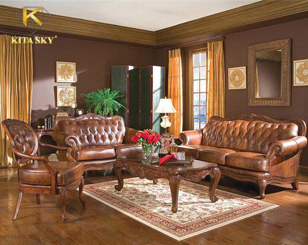 Sử dụng sofa gỗ bọc da với phần chân cao, tạo cảm giác thoáng đãng cho không gian