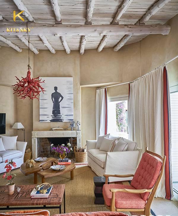 Bày trí sofa màu trắng trong không gian theo phong cách dân dã với cây gỗ nguyên khối