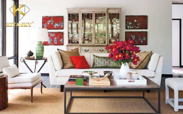 Một ý tưởng sofa màu trắng phòng khách ấn tượng. Khi kết hợp cùng những chiếc gối ôm hay tranh ảnh màu đỏ rực rỡ, trẻ trung.