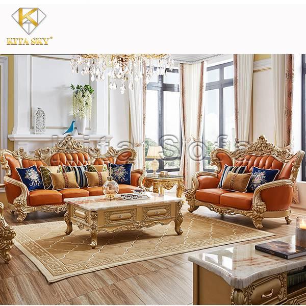 Sofa Tân Cổ Điển Mạ Vàng Jesse là sự phối hợp ăn ý giữa chất liệu bọc màu cam cùng ánh vàng xa xỉ đẳng cấp