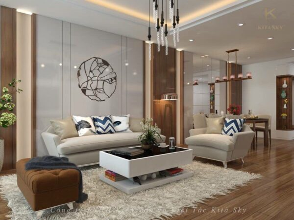 Phòng khách vô cùng ấm áp và sang trọng. Chỉ với một bộ sofa vải gọn gàng với thiết kế hiện đại được uốn lượn hoàn hảo. Cộng với chiếc đôn ghế màu nâu sang chảnh khiến không gian cực kỳ tinh tế. Điểm nhấn là vật trang trí trên vách tường với hình ảnh một đóa hồng cực kỳ thu hút và ấn tượng.